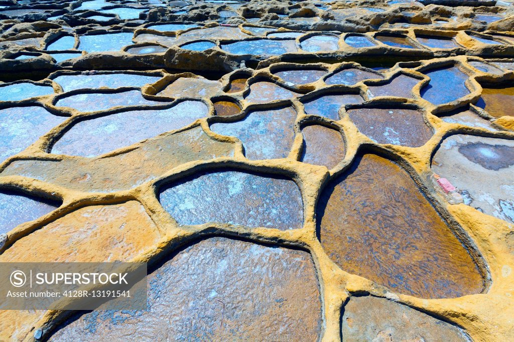 Stock Photo: 4128R-13191541 Salt evaporation ponds, Qbajjar, Gozo, Malta.