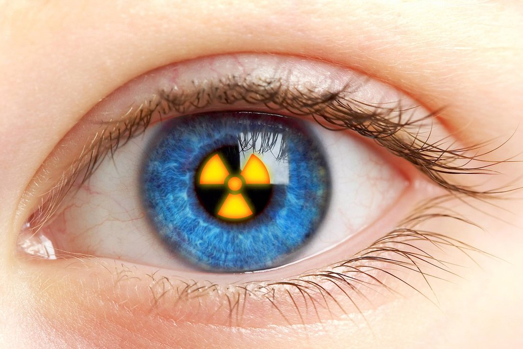 Stock Photo: 4128R-11924 Eye with radiation warning sign