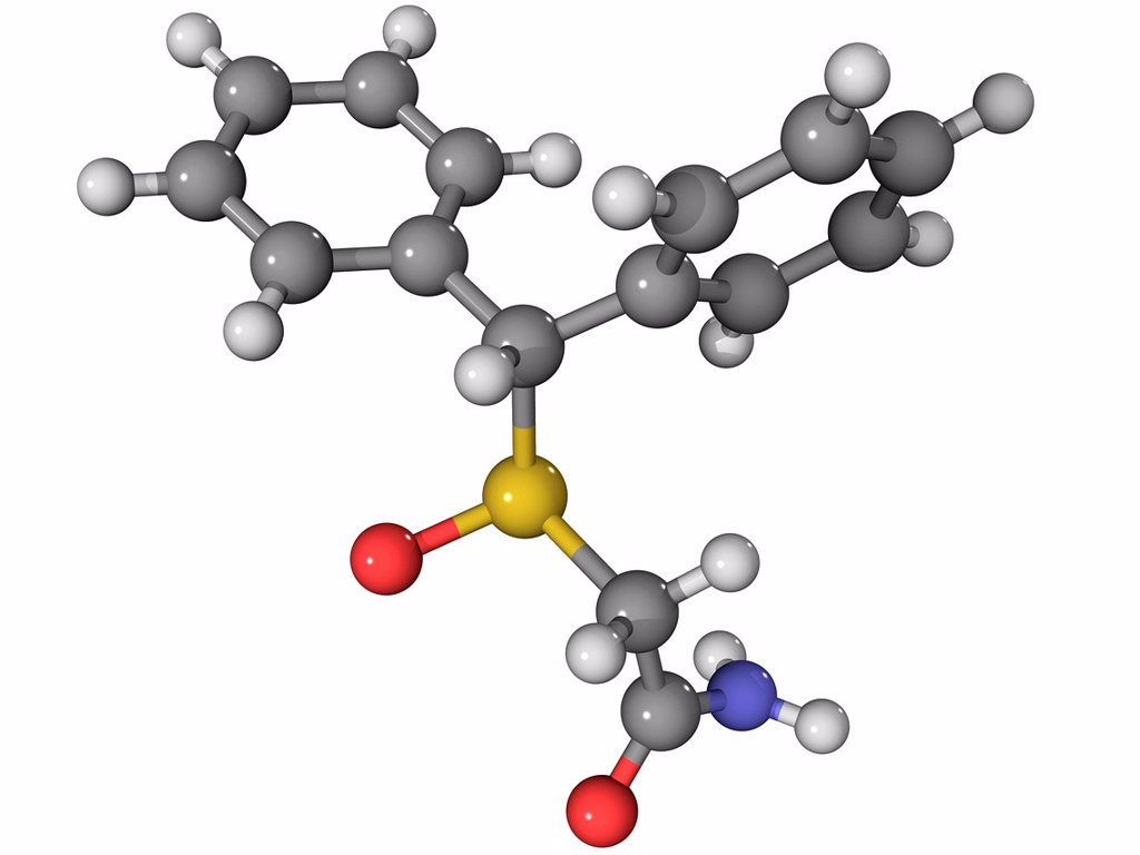 Stock Photo: 4128R-13910 Modafinil, molecular model. This stimulant drug is used to treat narcolepsy. Atoms are represented as spheres and are colour_coded: carbon grey, hydrogen white, oxygen red, nitrogen blue and sulphur yellow.