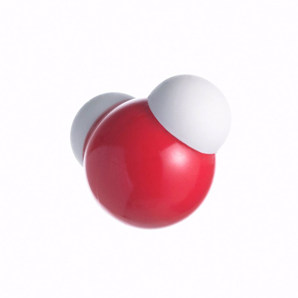 Water molecule. Atoms are represented as spheres and are colour_coded: oxygen red and hydrogen white. : Stock Photo