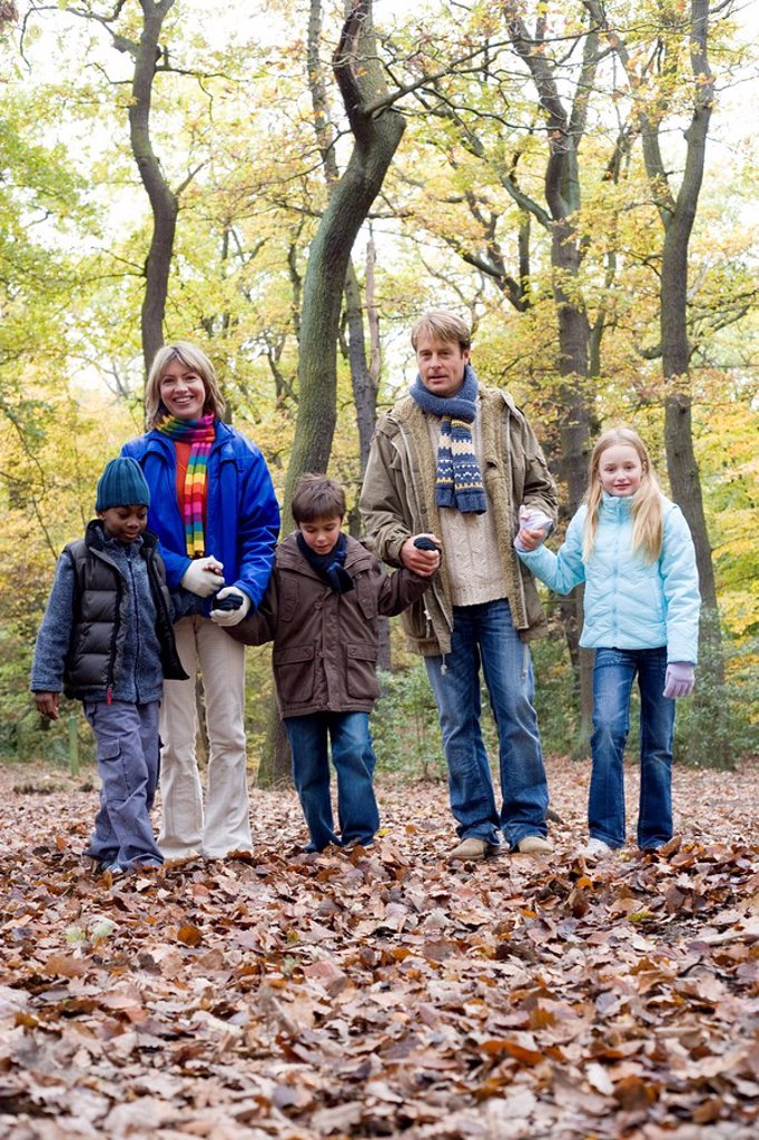 Parents and children in a wood : Stock Photo