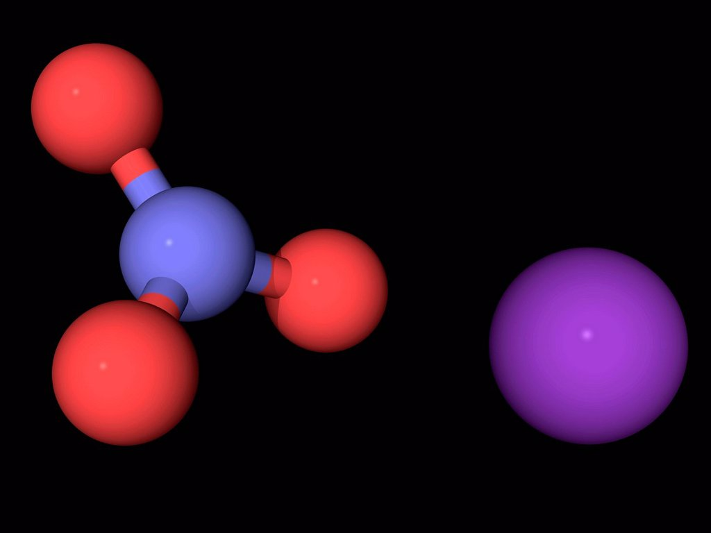 Potassium nitrate, molecular model. Chemical compound used in fertilizers, food additives, rocket propellants and fireworks. One of the constituents of gunpowder. Atoms are represented as spheres and are colour_coded: nitrogen blue, oxygen red and potassi : Stock Photo