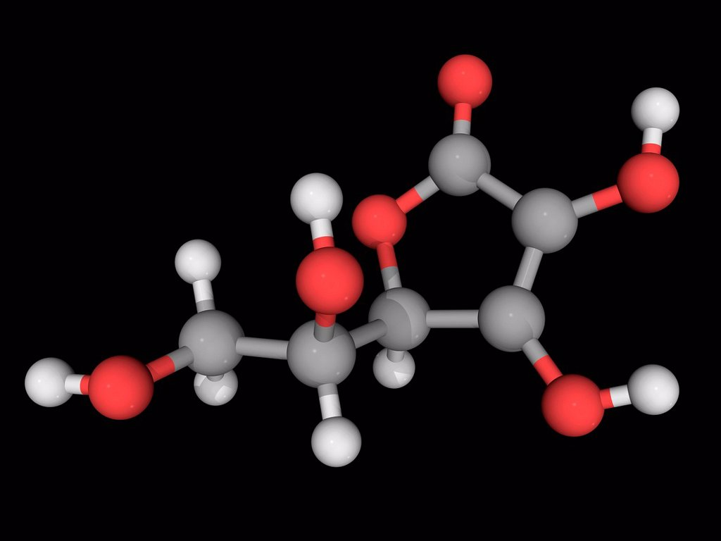 Stock Photo: 4128R-16672 Vitamin C ascorbic acid, molecular model. Vitamin required for protecting the body against oxidative stress. Atoms are represented as spheres and are colour_coded: carbon grey, hydrogen white and oxygen red.