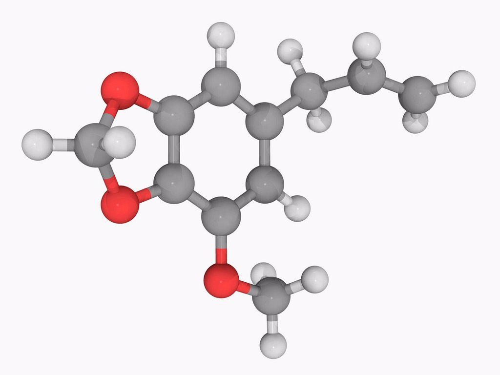 Stock Photo: 4128R-17021 Myristicin, molecular model. Natural organic compound found in the essential oil of nutmeg. Atoms are represented as spheres and are colour_coded: carbon grey, hydrogen white and oxygen red.