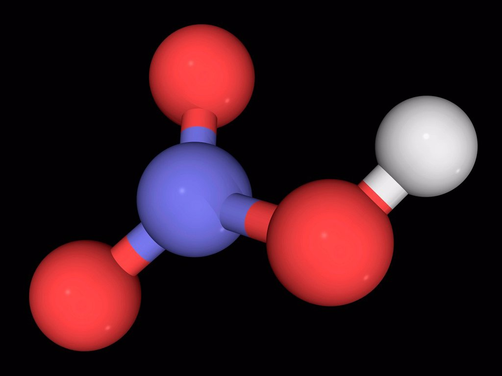 Nitric acid, molecular model. Highly corrosive and toxic strong mineral acid mainly used for the production of fertilizers. Also a strong oxidizing agent. Atoms are represented as spheres and are colour_coded: hydrogen white, nitrogen blue and oxygen red. : Stock Photo