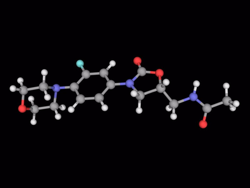 Stock Photo: 4128R-17481 Linezolid, molecular model. Synthetic antibiotic used for the treatment of serious infections resistant to several other antibiotics. Atoms are represented as spheres and are colour_coded: carbon grey, hydrogen white, nitrogen blue, oxygen red and fluorin
