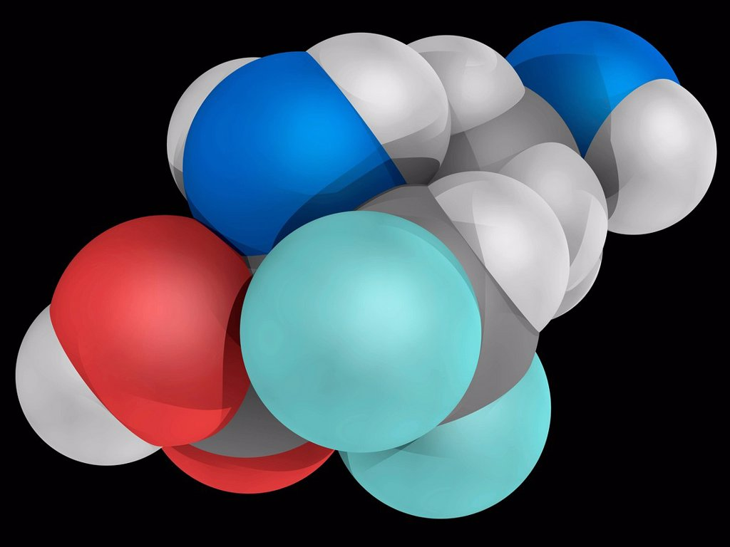 Stock Photo: 4128R-17712 Eflornithine, molecular model. Drug used in the treatment of facial hirsutism excessive hair growth. Atoms are represented as spheres and are colour_coded: carbon grey, hydrogen white, nitrogen blue, oxygen red and fluorine cyan.