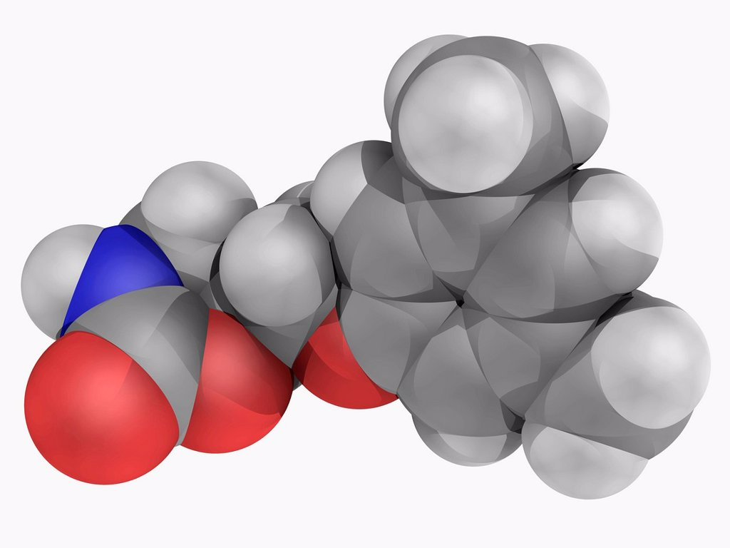 Metaxalone, molecular model. Drug used as a muscle relaxant and for relieving pain caused by strains, sprains, and other musculoskeletal conditions. Atoms are represented as spheres and are colour_coded: carbon grey, hydrogen white, nitrogen blue and oxyg : Stock Photo