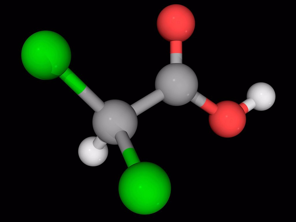 Stock Photo: 4128R-17999 Dichloroacetic acid DCA, molecular model. Analogue of acetic acid with two hydrogen atoms being replaced by chlorine atoms. Atoms are represented as spheres and are colour_coded: carbon grey, hydrogen white, oxygen red and chlorine green.