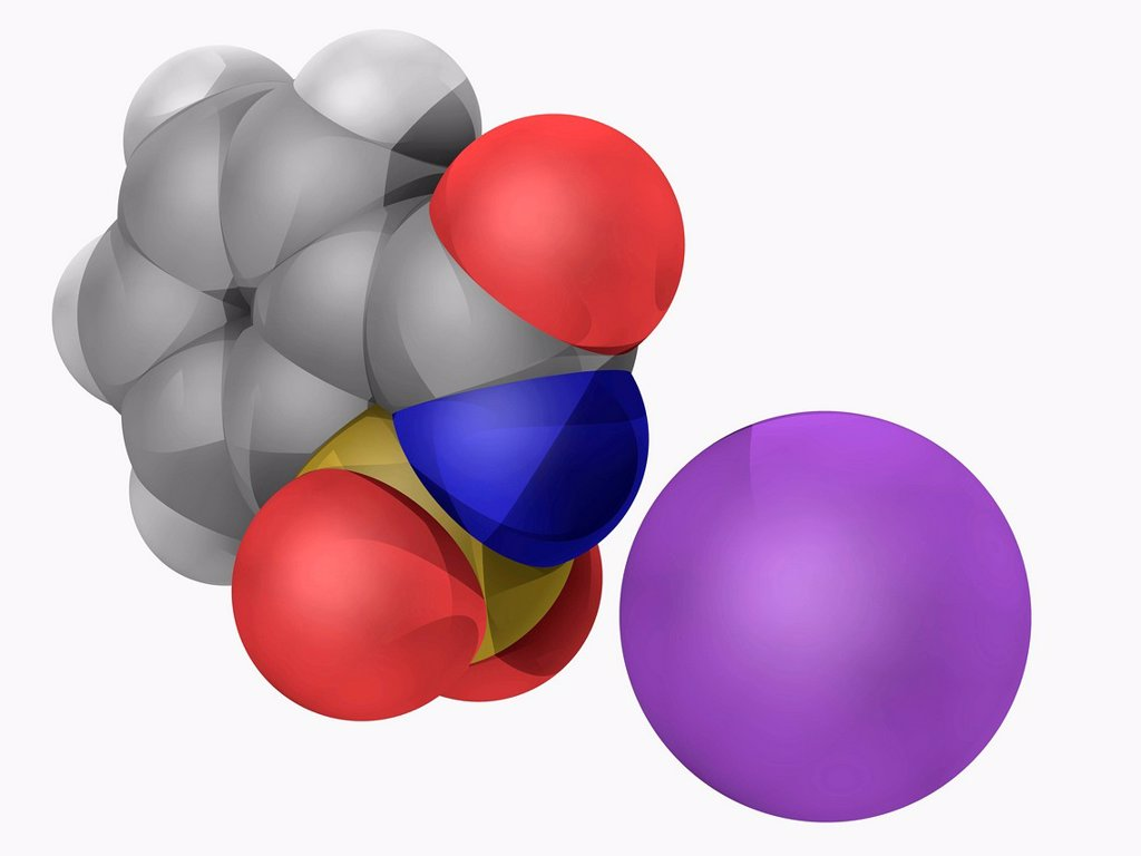 Stock Photo: 4128R-18345 Saccharin, molecular model. Saccharin sodium salt is a water_soluble artificial sweetener. Atoms are represented as spheres and are colour_coded: carbon grey, hydrogen white, nitrogen blue, oxygen red, sulfur yellow and sodium violet