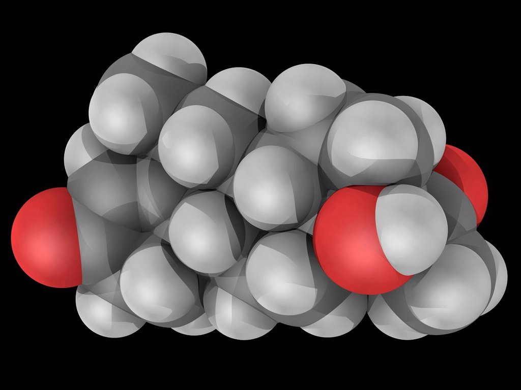 Medroxyprogesterone, molecular model. Drug acting as a progestin. Used to regulate irregular periods in a women´s menstrual cycle. Atoms are represented as spheres and are colour_coded: carbon grey, hydrogen white and oxygen red. : Stock Photo