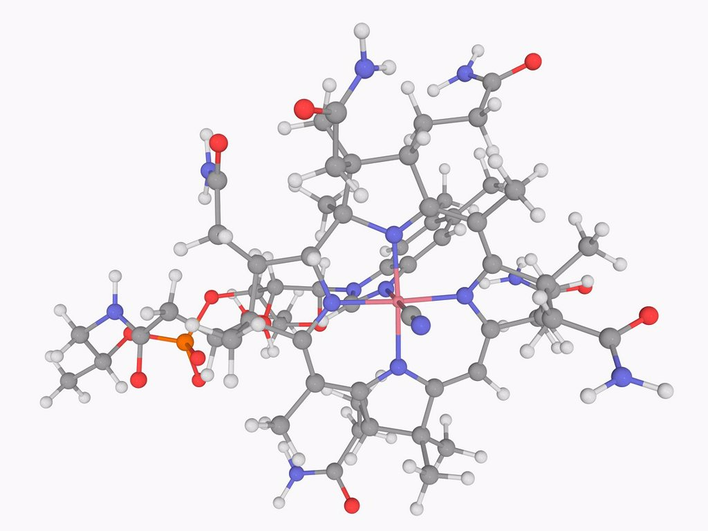 Stock Photo: 4128R-18644 Vitamin B12 cobalamin, molecular model. Vitamin playing a key role in the normal functioning of the brain and nervous system. Atoms are represented as spheres and are colour_coded: cobalt pink, carbon grey, hydrogen white, nitrogen blue, oxygen red and ph