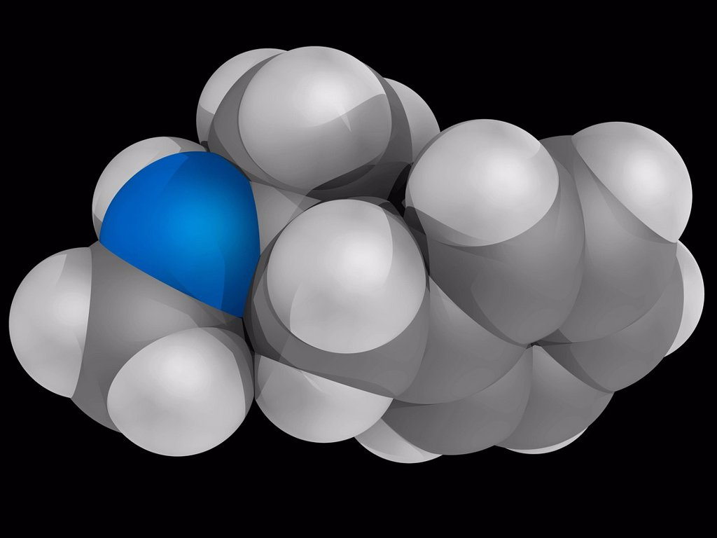 Stock Photo: 4128R-18784 Methamphetamine, molecular model. Psychostimulant of the phenethylamine and amphetamine class. High potential for abuse and addiction. Atoms are represented as spheres and are colour_coded: carbon grey, hydrogen white and nitrogen blue.