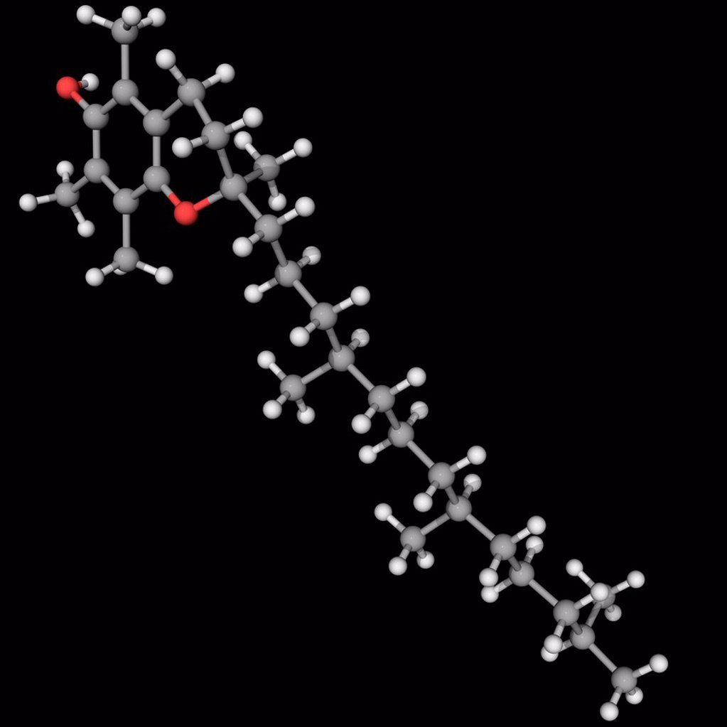 Stock Photo: 4128R-19035 Vitamin E, molecular model. Vitamin whose deficiency leads to neuromuscular problems. Atoms are represented as spheres and are colour_coded: carbon grey, hydrogen white and oxygen red.