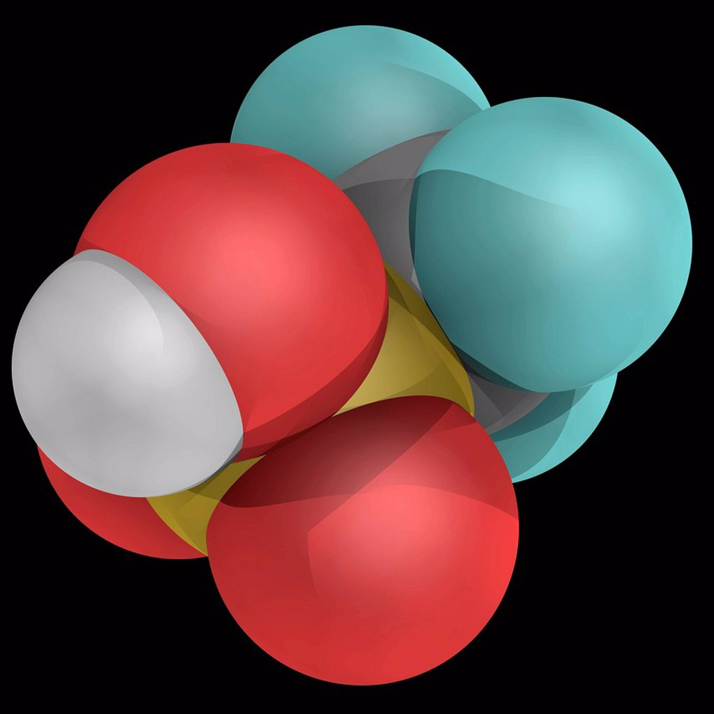 Trifluoromethanesulfonic acid, molecular model. One of the strongest acids, mainly used in research as a catalyst for esterefication. Atoms are represented as spheres and are colour_coded: carbon grey, hydrogen white, fluorine cyan, oxygen red and sulfur : Stock Photo