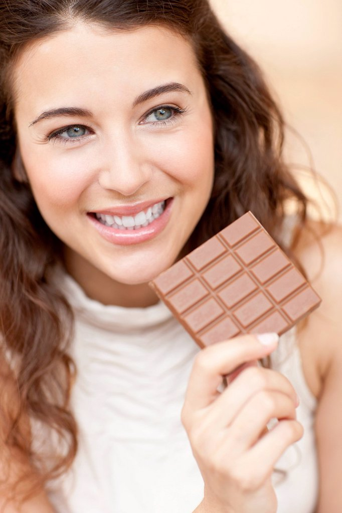 Stock Photo: 4128R-21077 Woman eating chocolate
