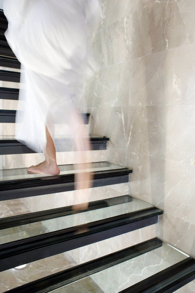 Stock Photo: 4128R-2487 Woman ascending stairs