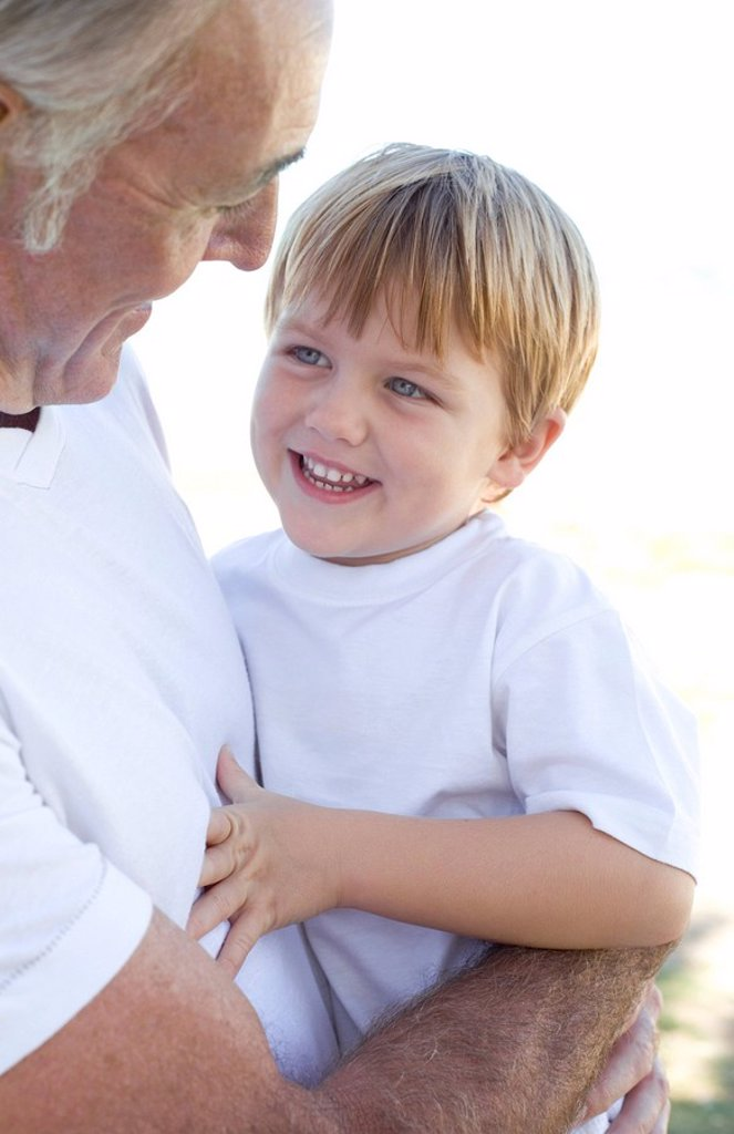 Stock Photo: 4128R-527 Grandfather holding his grandson