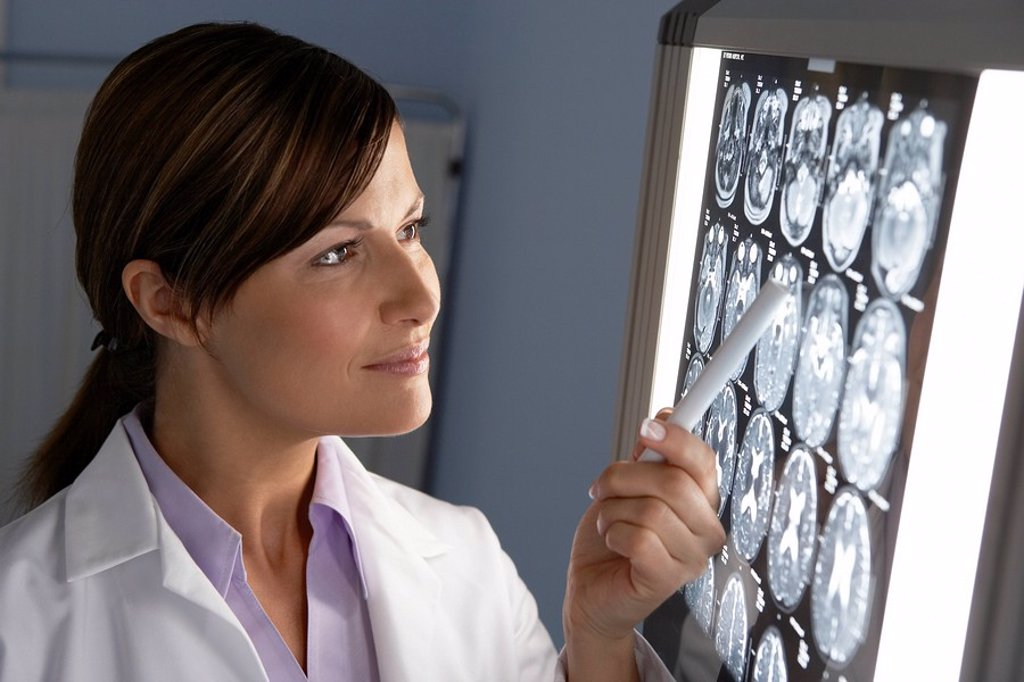 Stock Photo: 4128R-5286 Doctor examining MRI scans
