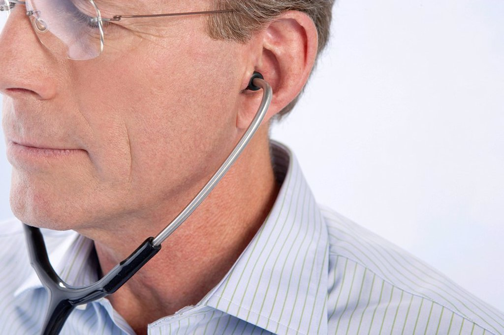 Doctor using a stethoscope : Stock Photo