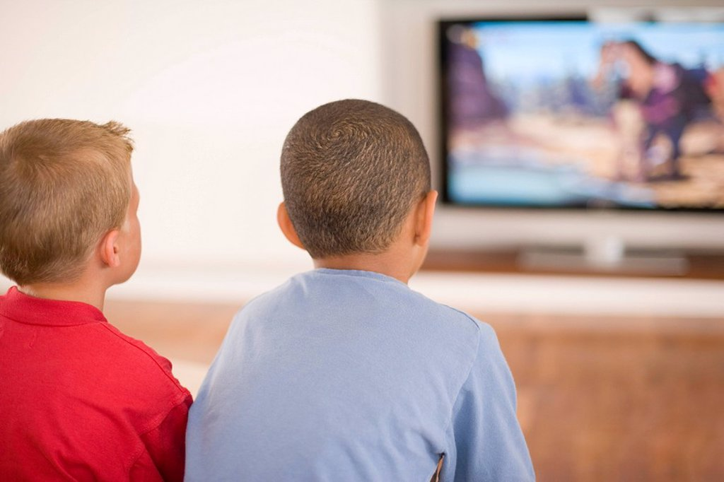 Children watching television : Stock Photo