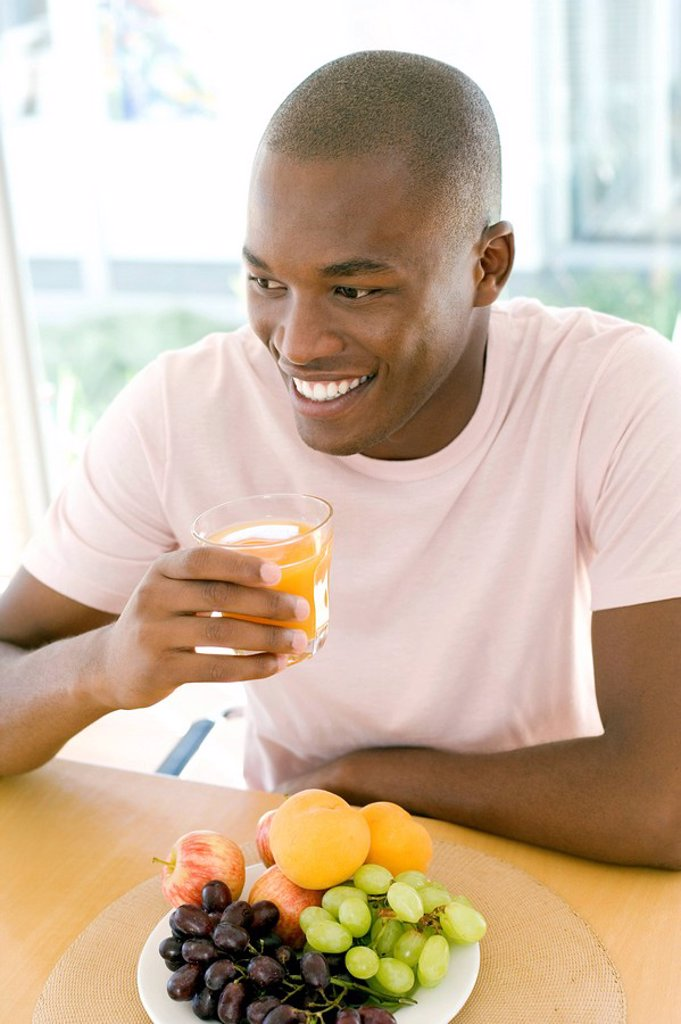 Man drinking orange juice : Stock Photo