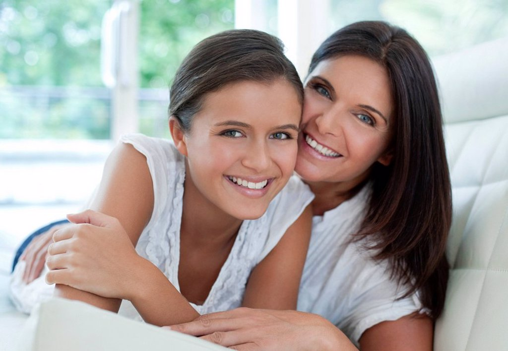 Mother and teenage daughter : Stock Photo