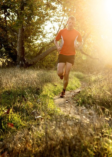 Stock Photo: 4135-125 Man running at sunset in a park, San Clemente Canyon, San Diego County, California, USA