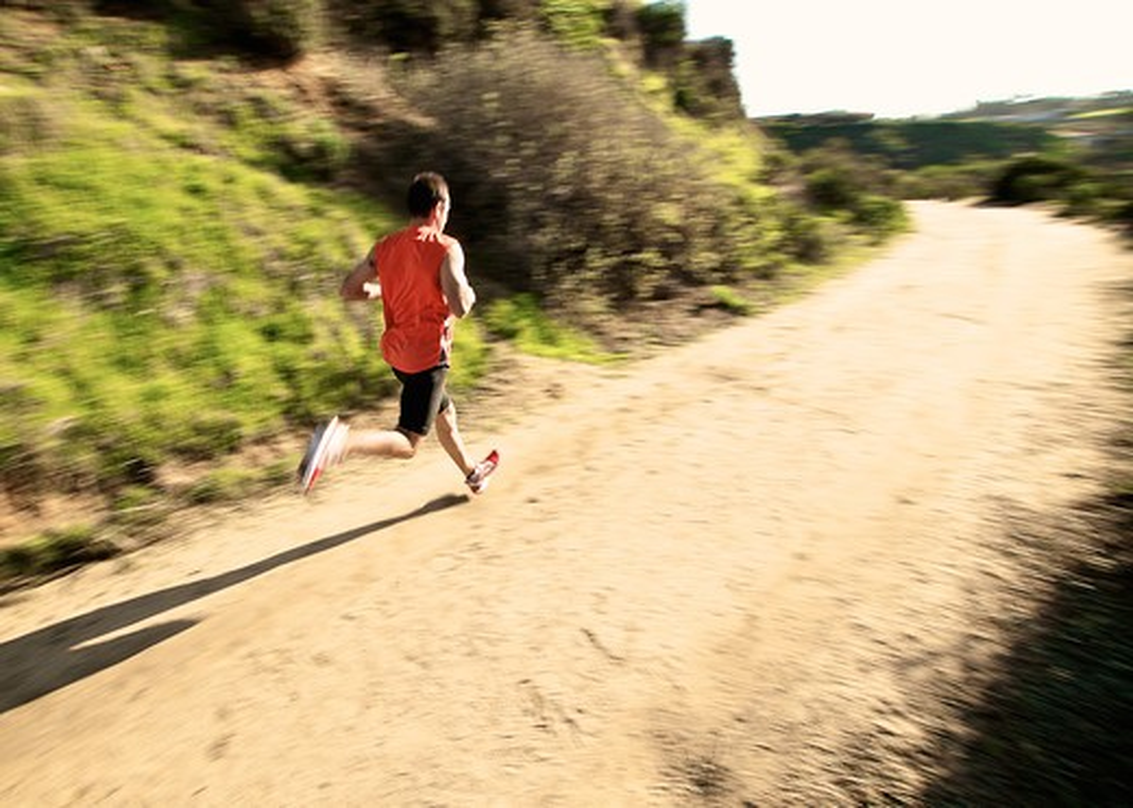 Man running along a wide trail, San Elijo Lagoon, Solana Beach, San Diego County, California, USA : Stock Photo