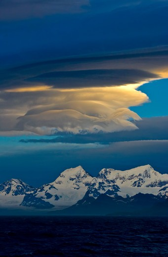 sunset showing lenticular clouds south georgia : Stock Photo