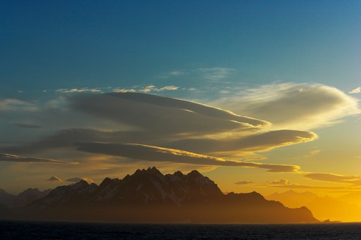 Stock Photo: 4141-1442 mountains and lenticularis clouds at sunrise, south georgia