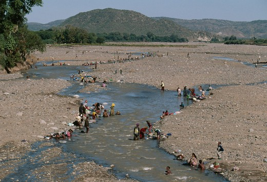 Stock Photo: 4141-16843 people bathing & washing in river k'ore, ethiopia