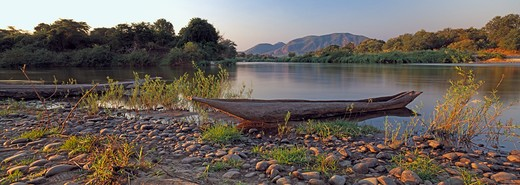 lukasashi & lunsemfwa rivers with traditional canoe in foreground luano valley, eastern zambia. : Stock Photo