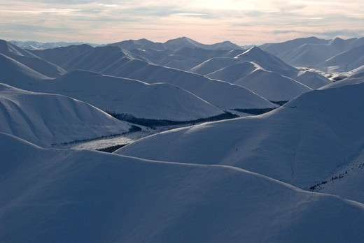Stock Photo: 4141-30350 aerial of snow covered northern ogilvie mountains in yukon territory, canada.