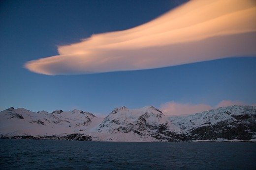 lenticular clouds over gold harbour at dawn; south georgia : Stock Photo