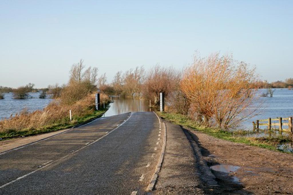 Stock Photo: 4141-36328 flooded road across ouse washes near welney norfolk, uk november