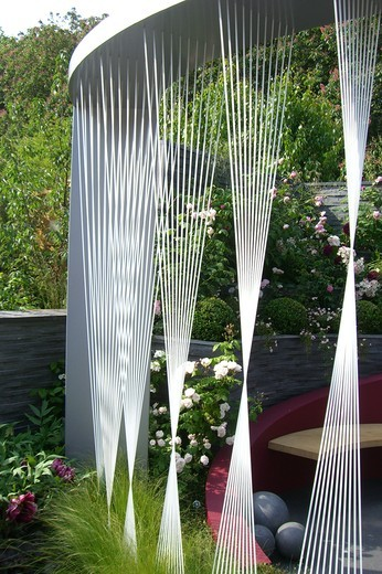 Stock Photo: 4141-36887 the lk bennett garden, a silver medal winning urban garden designed by rachel de thame, featuring a sculptural steel structure and a bench colour-coordinated with the planting. chelsea rhs flower show, london, england 2008 date: 22.10.2008 ref: zb1159_122662_0124 compulsory credit: photos horticultural/photoshot