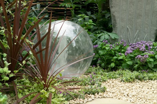 Stock Photo: 4141-45241 the way forward, a close-up of the glass globe water feature of this bronze medal winning courtyard garden at the 2008 chelsea rhs show, london, uk. date: 10.10.2008 ref: zb898_121950_0031 compulsory credit: photos horticultural/photoshot