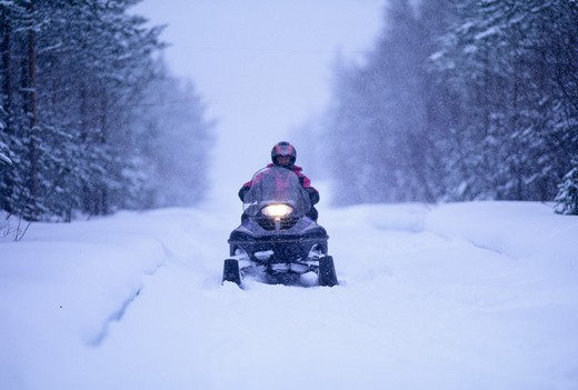 Stock Photo: 4141-48795 snow mobile on finnish track near ivalo in finnish lapland finland winter