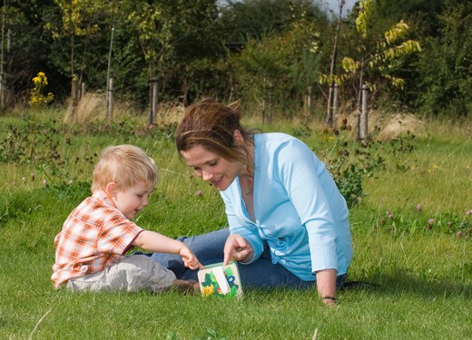 Stock Photo: 4141-48868 mother & toddler exploring nature kent uk summer
