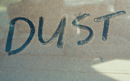 Stock Photo: 4141-53194 The Word 'Dust' Written On Car Rear Windscreen Following Saharan Sand Deposited In England By Strong South Easterly Winds
