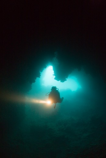 Stock Photo: 4141-53903 Diver At Entrance Of Chandelier Dripstone Cave, Micronesia, Palau