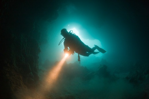 Stock Photo: 4141-53904 Diver At Entrance Of Chandelier Dripstone Cave, Micronesia, Palau