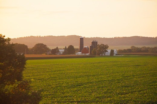 Stock Photo: 4141-54776 Farm In Wisconsin In Sunset Light, Viewed From The Amtrak Empire Builder Train, Usa, Empire_Builder-106 [Note: Not Property Released; For Editorial Use Only]