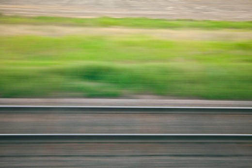 Motion Of Rails And The Passing Landscape Near The Tracks, Viewed From The Amtrak Empire Builder In Montana, Usa, Empire_Builder-274 : Stock Photo