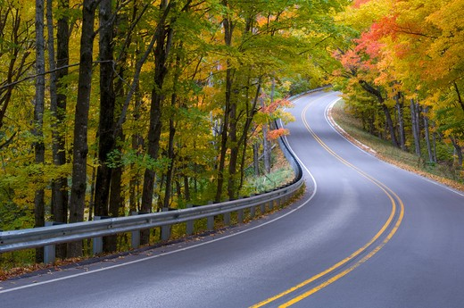 road & autumn forest pictured rocks national lakeshore michigan : Stock Photo