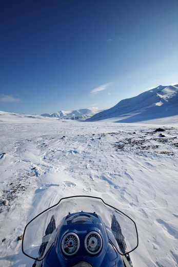 A snowmobile on a winter wilderness landscape : Stock Photo
