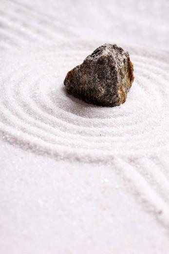 A rock in sand - zen rock garden : Stock Photo