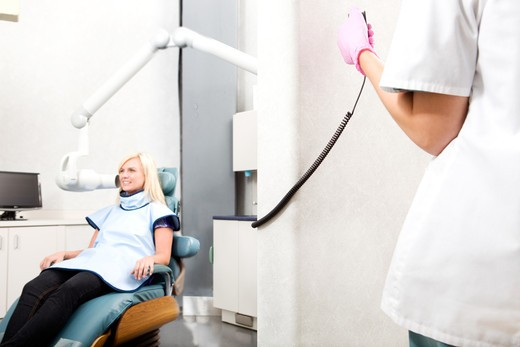 Stock Photo: 4148R-1614 A dentist taking an x-ray of a patient