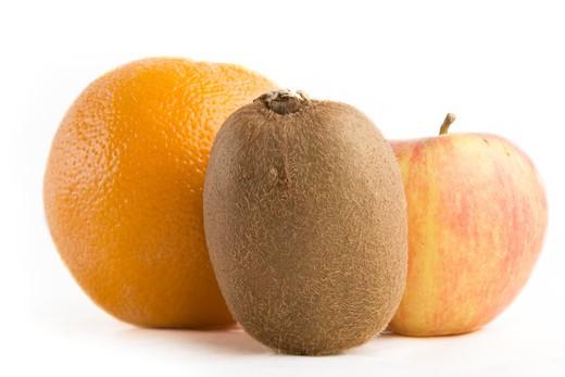 A group of fruit, an aple, kiwi and an orange. : Stock Photo